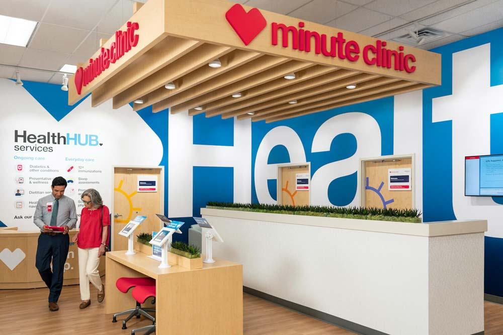 minute clinic inside CVS man helping woman