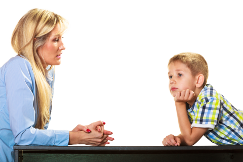 mother is talking to son about his behavior