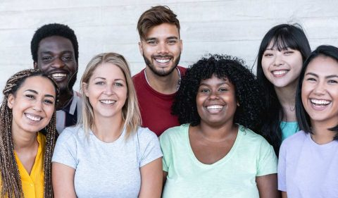 group of young college students smiling